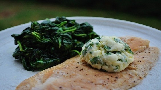 Chicken Paillard with Lemon and Parsley Butter Over Fresh Sauteed Spinach