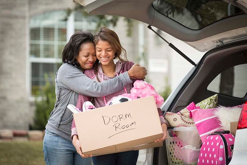 Mom & Daughter loading the car, off to college, dorm room box